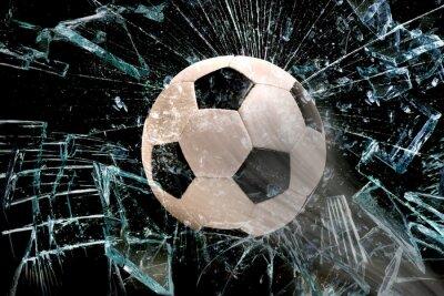 Vinilo El balón de fútbol a través del cristal.