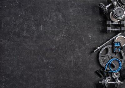 Vinilo Equipamiento deportivo sobre un fondo negro. Vista superior. Motivación