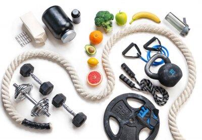 Vinilo Equipamiento deportivo y nutrición saludable sobre un fondo blanco. Vista superior. Motivación