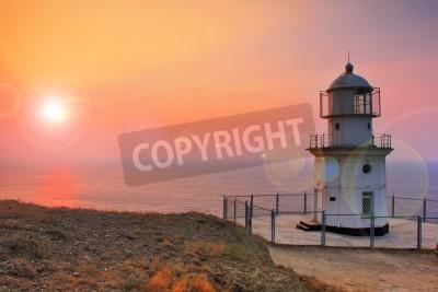 Vinilo Faro en la costa al amanecer