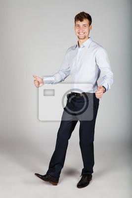 Vinilo Feliz sonriente hombre de negocios bailando mostrando sus pulgares.