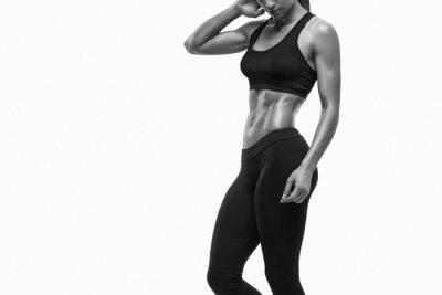 Vinilo Fitness mujer deportiva mostrando su cuerpo bien entrenado