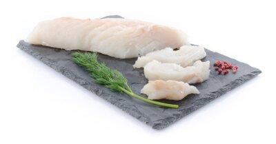 Vinilo Fresco filete de bacalao crudo en un plato de pizarra