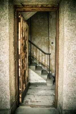 Vinilo Grungy abandoned home with door and stairs