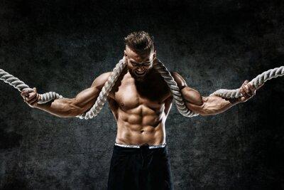 Vinilo Hombre musculoso con cuerda. Foto de hombre con cuerpo perfecto después del entrenamiento. Estilo de moda