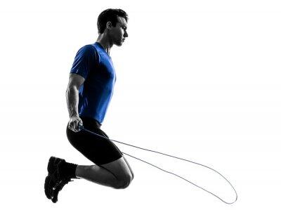 Vinilo joven el ejercicio de saltar la cuerda silueta