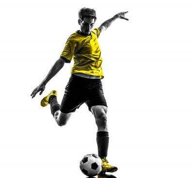 Vinilo joven jugador de fútbol brasileño de fútbol pateando la silueta