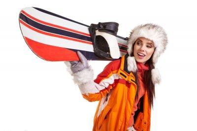 Vinilo Joven mujer de pie con snowboard aislado en blanco