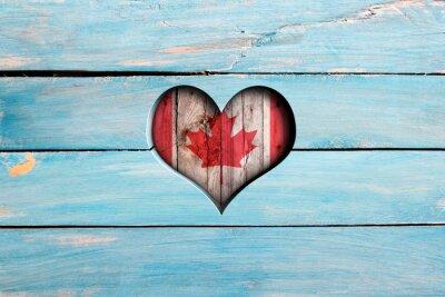 Vinilo Me encanta Canadá. Corazón y bandera en una tabla de madera azul