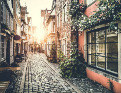 Vinilo Old town in Europe at sunset with retro vintage Instagram style filter effect