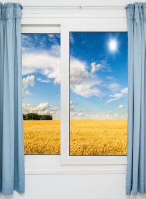 Vinilo paisaje de la naturaleza con una vista a través de una ventana con cortinas