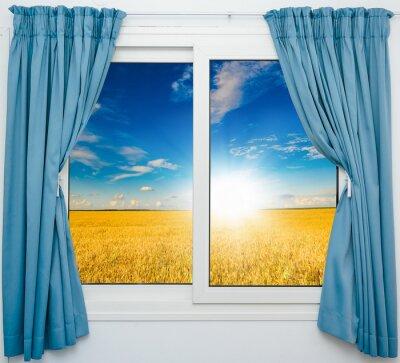 Vinilo Paisaje natural con una vista a través de una ventana con cortinas