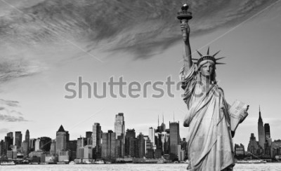 Vinilo photo statue of liberty new york city black and white hi contrast. nyc new york city skyline over Manhattan cityscape midtown. statue of liberty over hudson river in new york city.