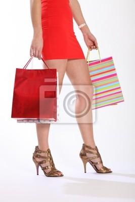 fac90f1ef768a Vinilo Piernas atractivas de la mujer caminando con bolsas de la compra