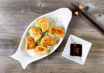 Vinilo Plato chino de albóndigas fritas con salsa de inmersión listo para comer