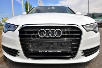 Vinilo PRAGUE, THE CZECH REPUBLIC, 02.08.2015 - Brand new white Audi A6 parks in front of Car Store Audi