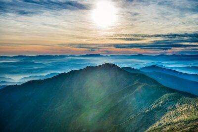 Vinilo Puesta de sol en las montañas
