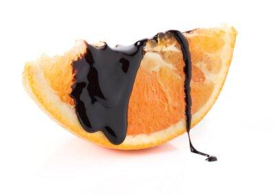 Vinilo rodajas de naranja con hilos de chocolate derretido