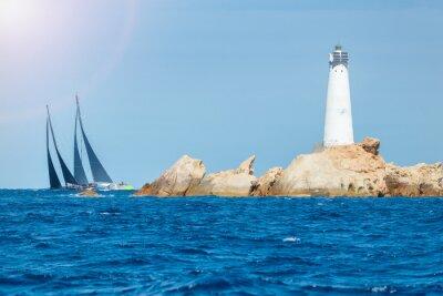 Vinilo sailing in Sardinia, Monaci island lighthouse, Italy
