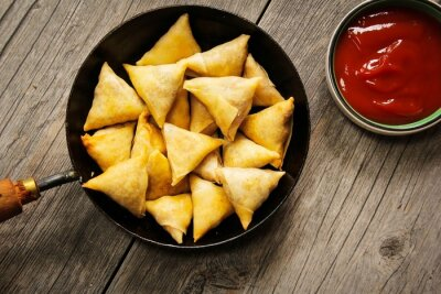 Vinilo Samosas - Popular Indian deep fried snack with potato filling and covered with crispy crust