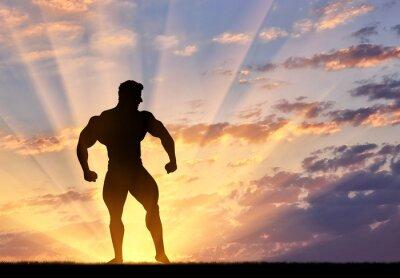 Vinilo Silueta de bodybuilder plantea al atardecer