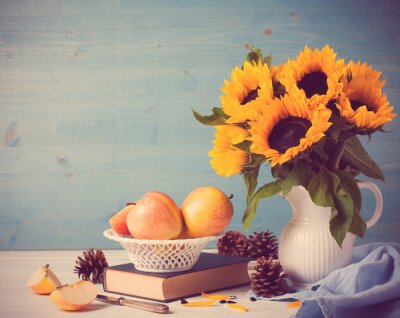 Vinilo Sunflowers bouquet in white vase with apples