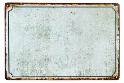 Vinilo Una vieja muestra de metal oxidada en blanco con un fondo de espacio de copia para su texto