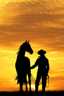 Vinilo Vaquero con caballo al atardecer