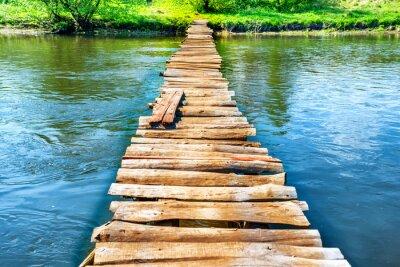 Vinilo Viejo puente de madera a través del río