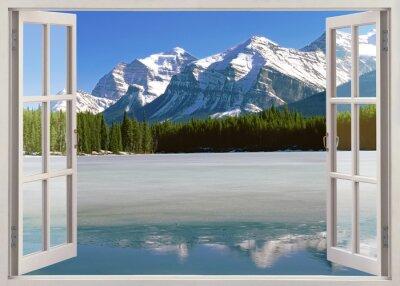 Vinilo Vista panorámica de las montañas Rocosas Canadienses desde la ventana abierta